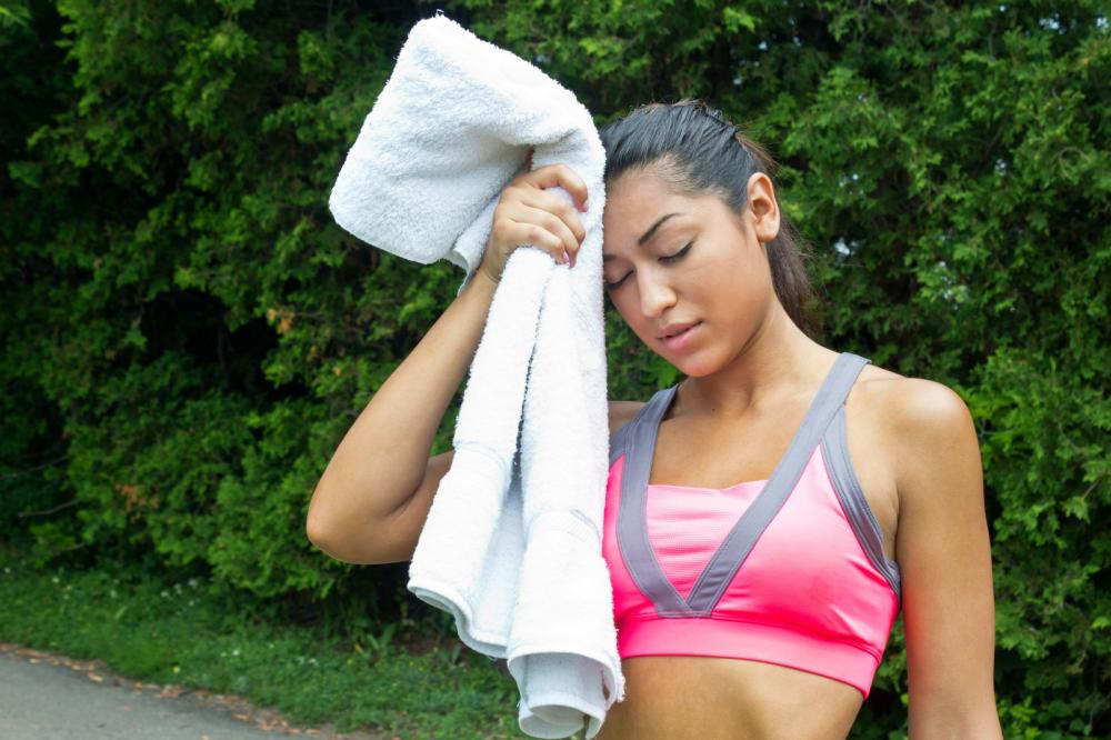 woman-towels-off-and-rests-after-running